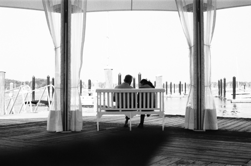A couple conversing under the Thames Street Landing Tent