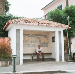 A man waiting outside of the entrance to the hot springs.