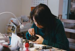 Mrs. Ye working on a Summicron R lens