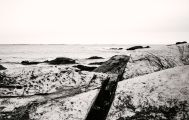 The ocean smooths the rock formations at the refuge. Footing is tenuous and requires care.